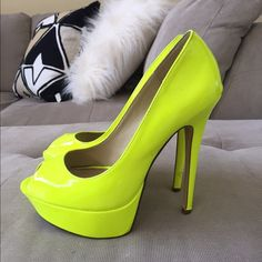 Neon yellow heels Stand out of the crowd in these awesome shoes! Neon yellow platform peep toe. Good condition, a few minor scuffs on the heels as shown in pics 3 and 4 ALDO Shoes Heels
