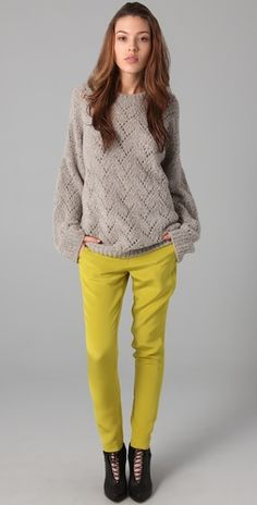Pair a slouchy neutral sweater with a bright coloured pants to nail this casual comfy look.