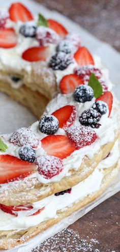 A great puff pastry recipe with puff pastry, cream, and fresh berries. A perfect holiday dessert. Puff Pastry wreath recipe with be your new dessert recipe. #dessert #berries #blueberry #puffpastry #simpledessert