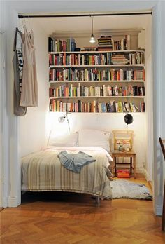 This is all the bigger a bedroom really has to be. You can keep more books under the bed.