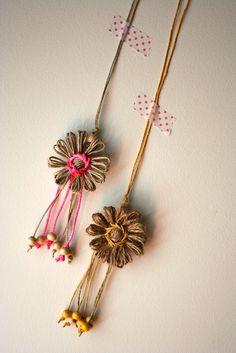 Flower loom pendants, via Flickr Made using a vintage flowerloom #flowerloom #vintagecraft