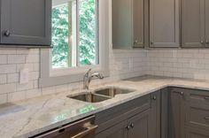 Gray Cabinets with subway tile backsplash