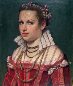 Head band of gold and pearls, with pendant and drop pearl at center part.  Pretty bows around the braid.  Black and gold necklace, small beads.  Large gold chain and 'tube' bead necklace.  1550s Moroni Portrait of Isotta-Brembatti  Grumelli