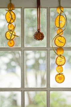 Dried Orange Garland - This site doesn't say how to do it, but Good Housekeeping says slice evenly, spread on a baking sheet & bake at 150 for four hours.  So pretty!