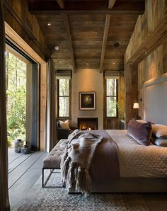 Dream bedroom in the woods #bedroom #idea #big #window #wood #cottage #house #inthewoods #view #fireplace #beams #wood #throw #plaid #textile #decor #interior #design
