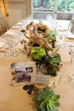 Photos of the bride and groom on hiking trips coordinated with each table name.