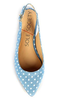 Darling light blue slingback flat with white polka dots and a pointed toe