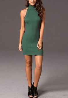 Full front view of model in dark green cross-back bodycon dress