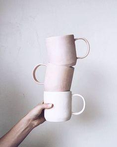 stacking ceramic blush colored mugs