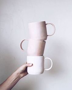 stacking ceramic blush colored mugs