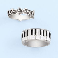 $19.98 Stainless Steel Piano Keys Ring: The music-notes ring is antiqued sterling silver and the piano-keys ring is enameled stainless steel. Notes and piano keys wrap around the bands. They're perfect for music lovers! Gift boxed. Ring Sizes: Music Notes, whole sizes 5-9; Piano Keys, whole sizes 5-12.