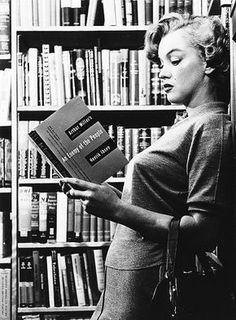 she was a reader - and note the author on the book she's holding...