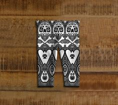 """Love and Bones"" is an original Embrace the Weird baby leggings design by eccentric visual artist Brian A. Bernhard."