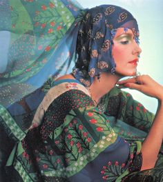 Model wearing a caftan and headdress by Thea Porter for Vogue UK, 1975. Photo by Barry Lategan.