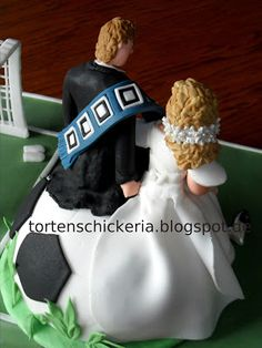 soccer themed fondant wedding cake with large football and HSV colors and bride and groom