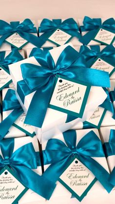 Teal wedding favor gift boxes with satin ribbon bow and custom tag. Elegant Personalized bonbonniere for gifts and favors for your guests. #welcomebox #giftbox #personalizedgifts #weddingfavor #weddingbox #weddingfavorideas #partygift #bonbonniere #weddingparty #sweetlove #favorboxes #candybox #tealwedding #uniqueweddingfavor
