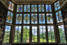 Stained glass window, overlooking gardens of Montacute House. Montacute House is a late Elizabethan mansion with garden in Montacute, South Somerset. The window of the Great Chamber depicts the arms of families connected to the Phelips by marriage.