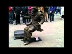 HOW DOES HE DO THIS?? This guy deserves some credit...I don't think I've ever seen a human statue on the street draw as large a crowd as he has.