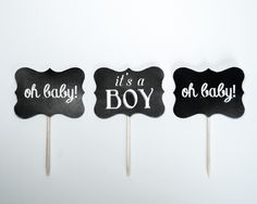 """12 handmade chalkboard designed paper cupcake toppers with a mix of """"Oh Baby!"""" and """"It's A Boy"""". Created with heavy cardstock."""
