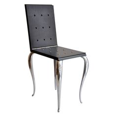 Philippe Starck Lola Mundo Chair  France  1980s  Ebonized wood chair that can be transformed into a table or stool by the brilliant French designer Philippe Starck (b. 1949). The cast aluminum cabriole legs suggest a historical reference yet Starck's design is very modern. An example of this chair is included in the permanent collection of The Museum of Modern Art, New York, and the Musee des Art Decoratif, Paris. Manufactured by Driade, Italy.