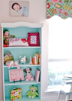 Paint the interior of a bookcase for a fun pop of color in the nursery or kids room!