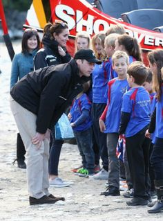 Catherine Duchess of Cambridge and Prince William, Duke of Cambridge talk to children after disembarking the Shotover Jet