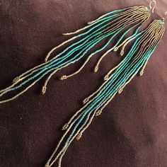 Maui Swan Designs beautiful, delicate earrings. Glass Seed Beads (size #15) hand…