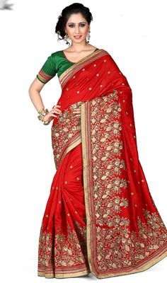 Look like a pretty doll in this red color embroidered kanchi silk sari. This engaging saree is showing some unbelievable embroidery done with lace and resham work. Upon request we can make round front/back neck and short 6 inches sleeves regular saree blouse also. #TrendyLookRedKanchiSilkSari