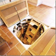 Trap Door Root Cellar Design Okay, it is really designed for wine, but I think it would be neat. Spiral Wine Cellar, Root Cellar, Beer Cellar, Floor Design, House Design, Underground Cellar, Casa Loft, Wine Cellar Design, Trap Door