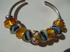 Whirling Amber Galaxy From a Trollbeads Gallery Forum member!  Great bangle design!