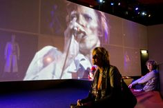 """Visitors watched videos at the """"David Bowie Is"""" exhibition in Groningen, the Netherlands, on Monday."""