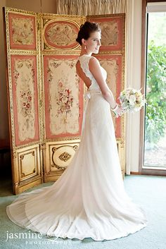 Reminds me of my wedding dress, low back and long bow...sigh.