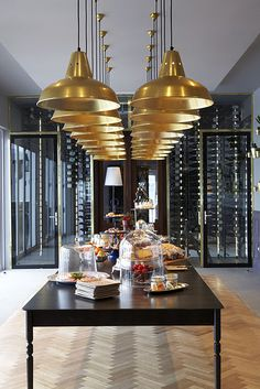 Black and Gold. Spectacular glass walls house a wine cellar.