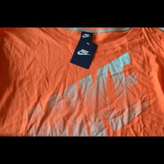 NWT Nike Long Sleeve NWT Nike Long Sleeve, orange, box-style design= loose on the body and material falls straight down, tight arms, small size Nike Tops Tees - Long Sleeve