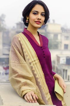 purple kurta with gold dupatta