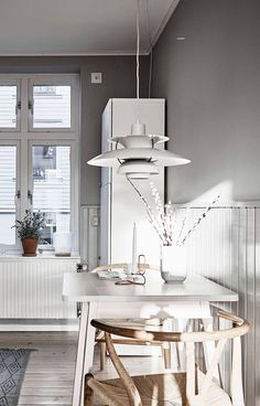 PH5 pendant by Poul Henningsein from Louis Poulsen and Wishbone chair by Hans J. Wegner from Carl Hansen & Søn | Home in grey and brown - via Coco Lapine Design
