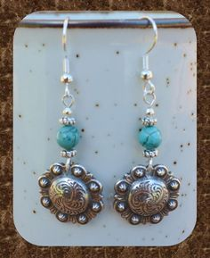 "2"" western concho earrings with turquoise howlite stone beads.  $15  You can find me on Facebook at Bandana Janna's Gemstone Jewelry & Accessories"
