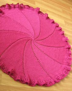 Free knitting pattern for Pinwheel Baby Blanket - Genia Planck created a simple round baby blanket that is knit in the round (so no purl rows!) with simple eyelet lines. It looks hard but it isn't. It is easily customizable. The pictured project by elsteffo added a ruffle border.