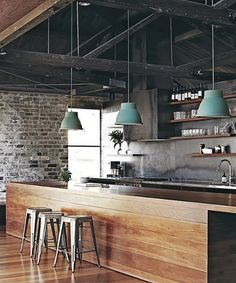 Industrial chic-style kitchen with exposed beams and open-shelving