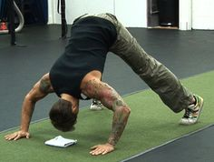 Pike Push-Up     Great for building rock-hard shoulders.  (see video)   This is the perfect exercise to develop the necessary strength, endurance, and stability as you work your way up to the Handstand Push-Up. If you have a lot of mass or are still working on loosing a few pounds, this is a great way to work the vertical pressing pattern.  As you get stronger and/or lose weight, you can begin to elevate the feet.