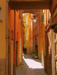 Italy, colours and light reflection in close buildings