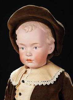 boy's velvet costume. Condition: generally excellent. Marks: 8 Germany 7081. Comments: Gebruder Heubach,circa 1910. Value Points: rare larger size with superlative sculpting of hair,eyes,mouth,and impressed dimples in cheeks and lip corners.