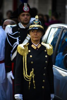 """City police and """"carabinieri"""" in high uniform also following the procession of Saints Cosmas and Damian in my parents' hometown, Eboli, in Southern Italy."""