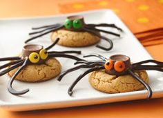Creepy Cookies: use slice & bake cookie dough. With some Rolos, m & m's, licorice, and black decorator gel