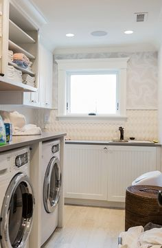Laundry room boasts open shelving flanked by closed cabinets over an enclosed fr. Laundry room boasts open shelving flanked by closed cabinets over an enclosed fr… Laundry Room Cabinets, Laundry Room Storage, Laundry Room Design, Laundry Rooms, Laundry Decor, Mud Rooms, White Beadboard, Custom Builders, Farmhouse Laundry Room