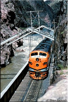 """At the famous Hanging Bridge over the Arkansas River Rio Grande F9A #5774 leads the appropriately named """"Royal Gorge"""" towards Denver during August of 1965."""