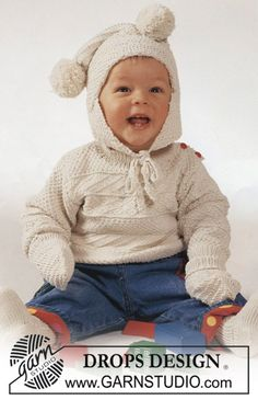 """Drops  Aran sweater and hat with pompoms  in """"Safran""""."""