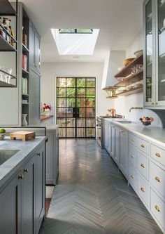 Steel frame windows in gorgeous grey and gold kitchen