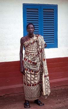 Africa | An official of the court of the Asantehene, king of the Asante people of Ghana, wearing an old adinkra cloth, Kumase 1997. | ©unknown, via Adire African Textiles