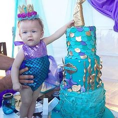 Merbabe™ wears one of my favorite pieces, our turquoise and lavender Mermaid Sparkle Romper®. We're obsessed with your mermaid parties!!! How gorgeous is this mermaid cake!  Tag us with #bellethreadsparty so we can see your merbabe's birthday details!!! #thatsparklerompertho #thatcaketho #sofreakingpinterestworthy